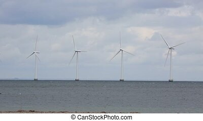 Wind tubines offshore - Offshore wind turbines at the sea in...