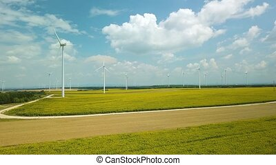 Wind tubines spinning, aerial footage - Many modern wind...