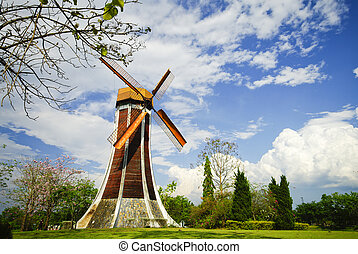 Wind turbine and blue clear sky in summer
