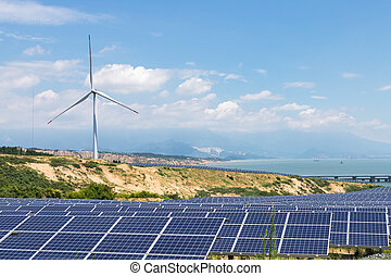 wind turbine and photovoltaic power station on lakeside, renewable energy landscape