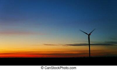 Wind turbine at sunset timelapse