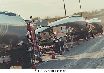 Wind Turbine Blades Shipping. Trucks Convoy with Elements of...