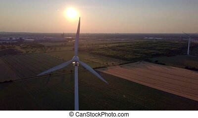 Wind turbine close up in front of the setting sun Wind Power
