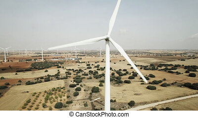 Wind turbine closeup, aerial view - Front view of working...