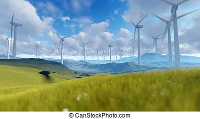 Wind turbine farm over green meadow against cloudy sky