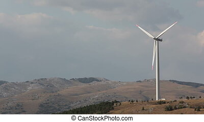 Wind turbine against sky with clouds. Mediterranean...