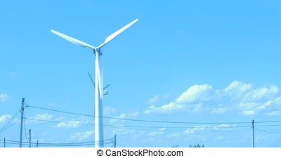 Wind Turbine for alternative energy on background sky. -...