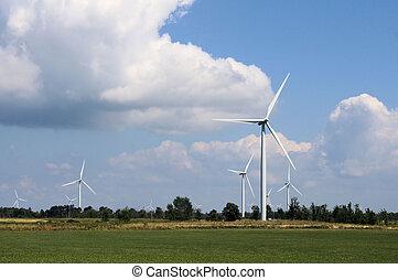 Wind Turbine in Field - White wind turbine in a...