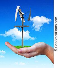 Wind turbine in hand.