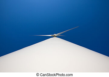 Odd angle of a wind turbine against blue sky