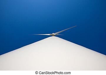 Wind turbine - Odd angle of a wind turbine against blue sky