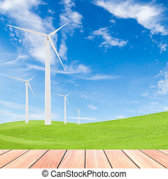 wind turbine on green grass field and blue sky background