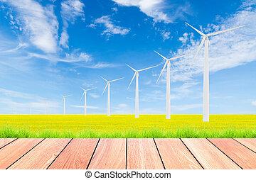 wind turbine on green rice field against blue sky background