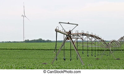 Wind turbine on green soybean field