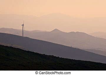 Wind Turbine on Hill - Wind turbine working on hill top at...