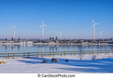Wind turbine on lake in winter