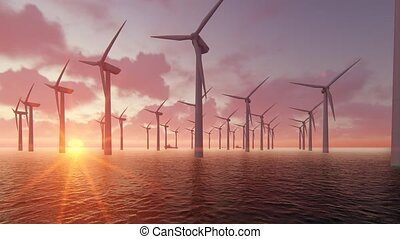 Wind turbine power generators silhouettes at ocean at sunset.