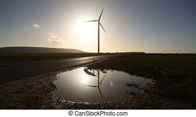wind turbine Reflexion - video footage of a wind turbine and...