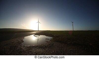 wind turbine Reflexion - video footage of a wind turbine and...