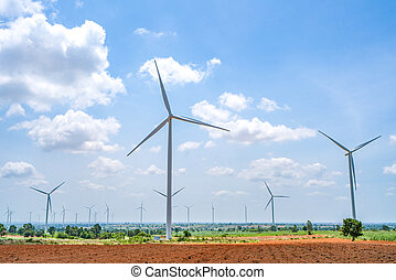 Wind turbine renewable energy source summer with blue sky.