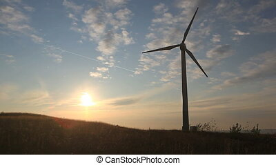 wind turbine - silhouette of wind turbines at sunset