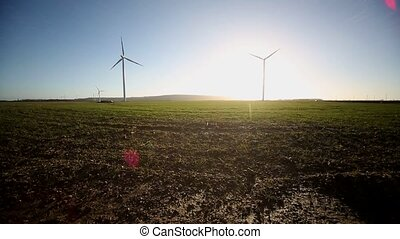 wind turbine With Sun - video footage of a wind turbine and...