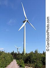Wind Turbines against Blue Sky at Summer