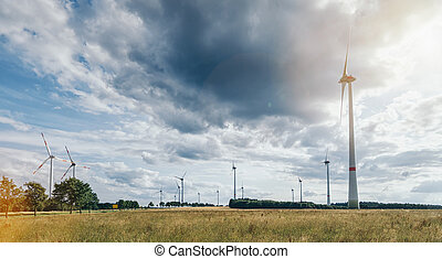 wind turbines against cloudy sky - Wind turbine park in a...