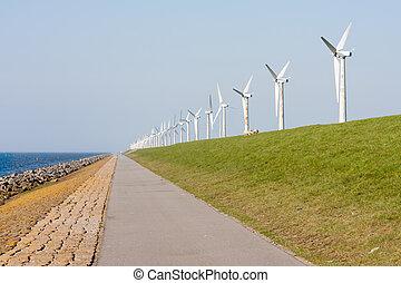 Wind turbines along a Dutch dike