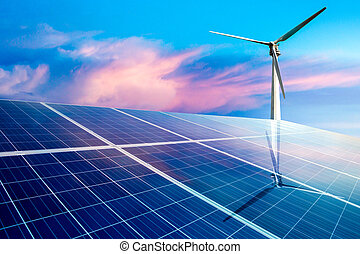 Wind turbines and solar panels closeup on sky background