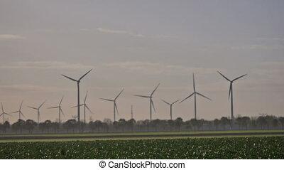 wind turbines as the sun rises