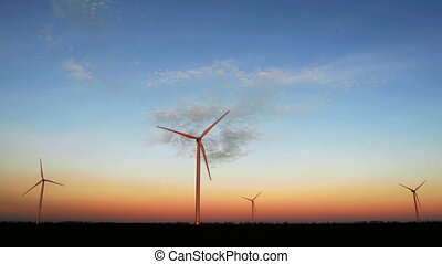 Wind turbines for alternative energy at sunset