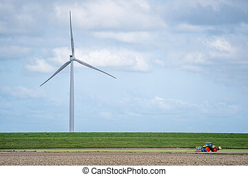 Wind turbines in a field of yellow tulips