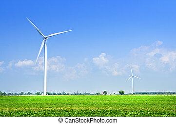 Wind turbines in field - Green alternative clean power wind...