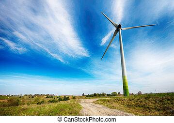 wind turbines in  fields under blue sky