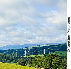 Wind turbines in mountains - Wind turbines in summer green...