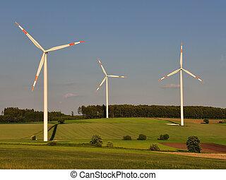wind turbines in open field