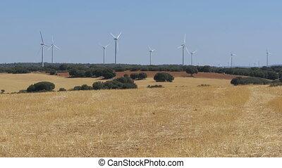 Wind Turbines in the Desert of Spain. Massive wind turbines...