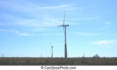 Wind turbines in the field. Eco-energy concept.