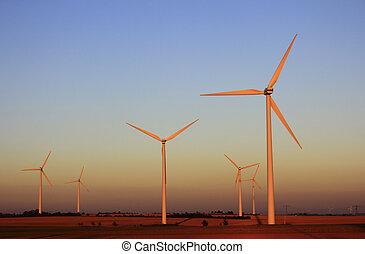 Wind turbines in the light of the setting sun
