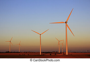 Wind turbines in the light of the setting sun