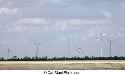 Wind turbines in the meadow produce alternative energy...