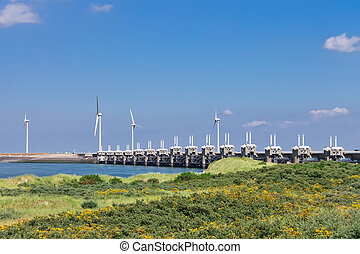 Wind turbines near the storm barrier. Netherlands
