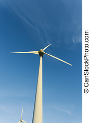 Wind turbines of a power plant for electricity generation in Normandy, France. Concept of renewable sources of energy. Environmentally friendly electricity production. Toned