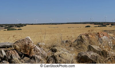 Wind Turbines on a Background of Stone in the Desert of Spain
