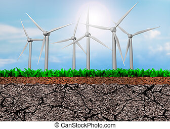 Wind turbines on green grass and dry soil cross section