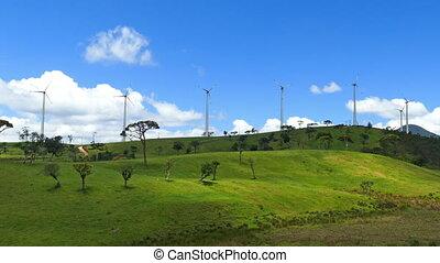 Wind turbines on green hills - wind farm