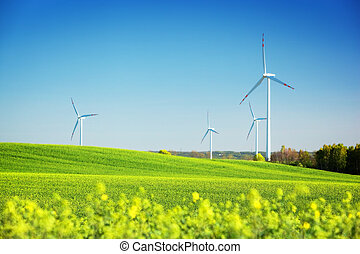 Wind turbines on spring field. Alternative, clean and natural energy