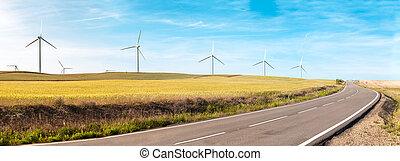 Wind turbines on summer field, green energy.