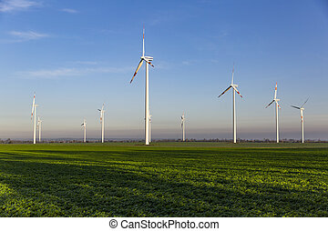 Wind turbines on the green field
